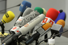 Microphones on a table during press-conference before UEFA Champions League football match between Dynamo Kyiv and FC Barcelona